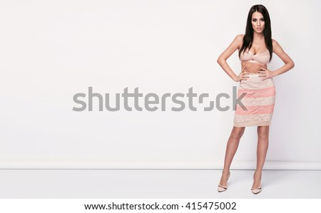 Beautiful sexy brunette woman, perfect body, nice hair style, nude bra - stock photo