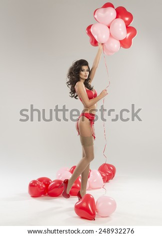 Beautiful sexy brunette woman posing in red lingerie. Valentine's day.  - stock photo