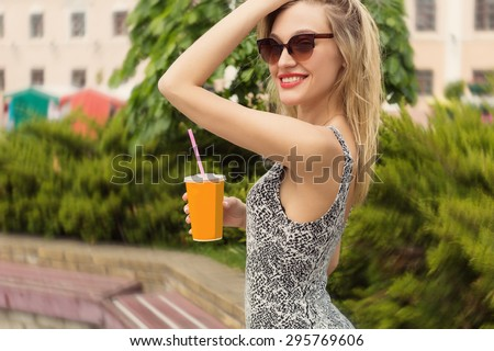 beautiful sexy cute happy smiling girl with a glass in his hand in sunglasses drinking a Coke on a sunny hot day - stock photo