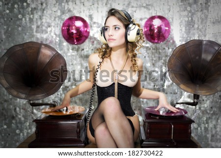 beautiful sexy disco dj in lingerie with gramophones. Perfect for stylish club, disco and fashion events  - stock photo