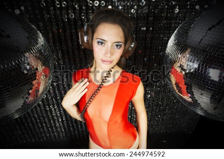beautiful sexy disco dj woman in lingerie surrounded by discoballs. Perfect for stylish club, disco and fashion events  - stock photo