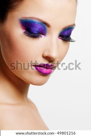 Beautiful sexy female face with bright beauty fashion make-up - stock photo