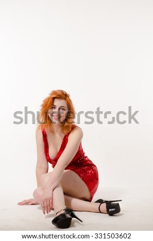 Beautiful sexy girl in a red dress on a white background