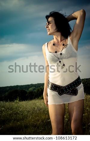 Beautiful sexy girl in summer field - stock photo