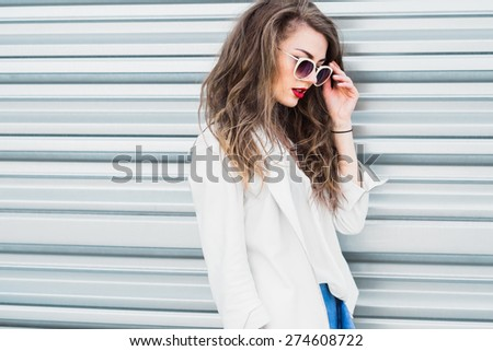 beautiful sexy girl in sunglasses on a summer sunny day - stock photo