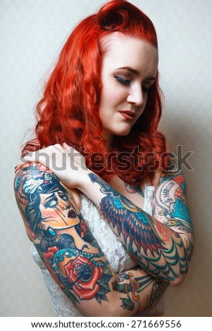Beautiful sexy glamorous girl with tattoos. tattoos. - stock photo