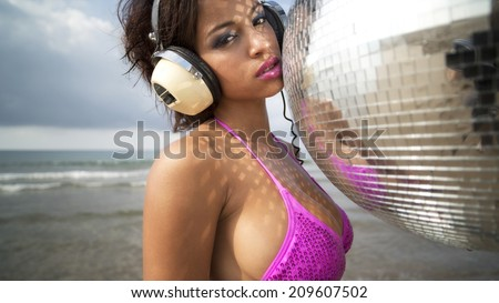 beautiful sexy latin bomb-shell dancing and posing at a beach in the early morning. useful for style fashion and music events - stock photo