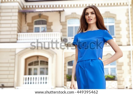 Beautiful sexy model woman wear stylish dress designer fashion clothes party date casual collection summer weather style pose hairdo walk on the city street historical building model pose makeup - stock photo