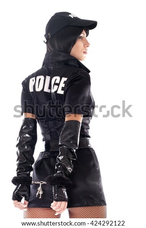 Beautiful sexy policewoman with handcuffs in a black uniform that aiming a gun. Isolated on white. - stock photo