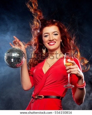 Beautiful sexy redhair woman with a glass of white wine and disco ball