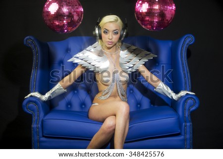 beautiful sexy silver disco woman with a speaker bra surrounded by discoballs. Perfect for stylish club, disco and fashion events  - stock photo