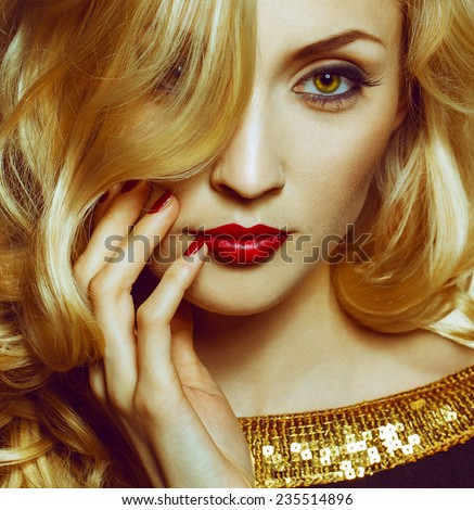 Beautiful Sexy Woman face closeup, makeup with Red Lips and Nails. Beauty blond Girl. Passion. Makeup, Hairdo and Manicure. Sensual Mouth. Sexy Red Color Lips. Gold bakground - stock photo