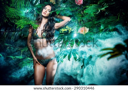 Beautiful sexy woman in bikini among tropical plants. Beauty, fashion. Spa, healthcare. Tropical vacation. - stock photo
