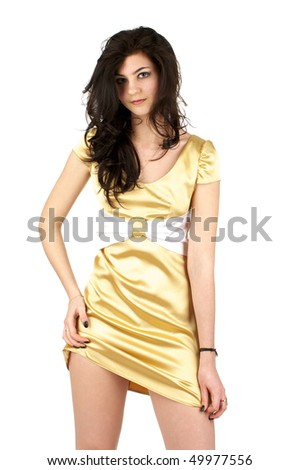Beautiful sexy woman in little yellow silk dress isolated over white background - stock photo