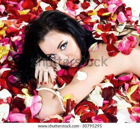 Beautiful sexy woman in rose petals - stock photo