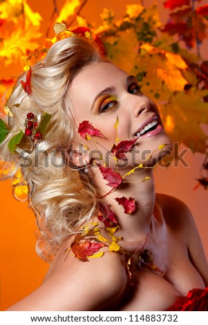 Beautiful, sexy woman in the image of autumn - stock photo