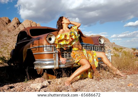 Beautiful sexy woman on old car - stock photo