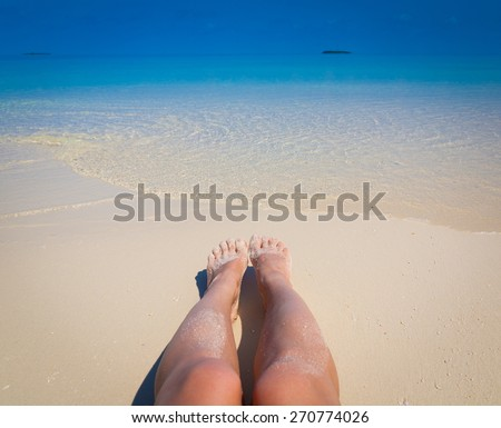 beautiful sexy woman tan legs blue sun sea tropical nature background holiday luxury  resort island atoll about coral reef amazing  fresh  freedom snorkel adventure. Coconuts   - stock photo