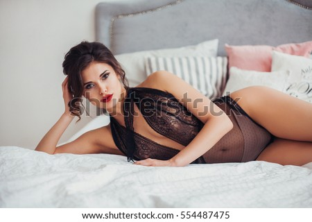 on poses Seductive bed lingerie