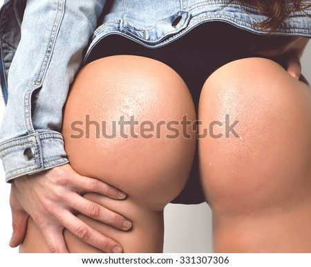 Beautiful sexy woman wet ass butts with water drops on a white background