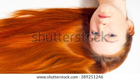 Beautiful sexy woman with red hair. closeup portrait of a beautiful young woman with elegant long shiny hair , hairstyle , isolated on white background - stock photo