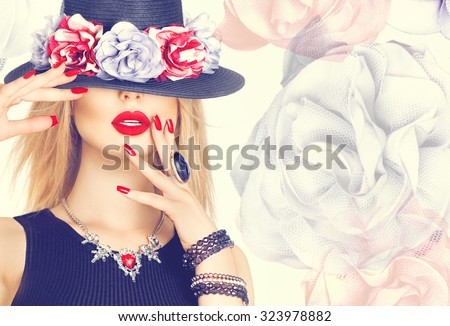 Beautiful sexy woman with red lips and manicure in modern black hat. Beauty fashion model girl with accessories- rings, bracelets, necklace and elegant hat decorated with flowers - stock photo