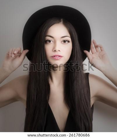 beautiful sexy women in black hat - stock photo