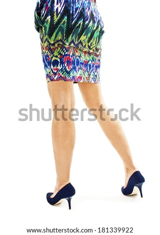 Beautiful, sexy, women's legs in blue shoes from the back. Isolated on white background  - stock photo