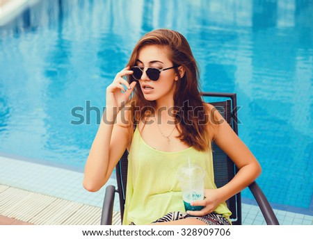 Beautiful sexy young brunette girl with long thick wavy hair thin slender figure perfect body and pretty face wearing glamorous suit,Golden Tan looks into the camera makeup artist cosmetic beauty - stock photo