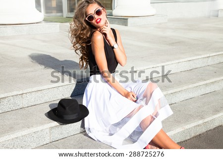 Beautiful sexy young business woman blond hair evening makeup wearing dress suit top skirt high heels shoes business clothes for meetings walks summer fall collection perfect body shape glasses hotel  - stock photo