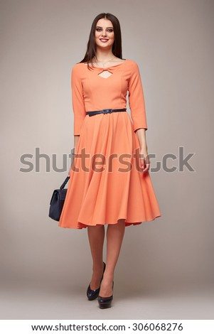 Beautiful sexy young business woman brunette hair evening makeup wearing dress suit top skirt high heels shoes business clothes for meetings walks summer fall collection perfect body shape - stock photo