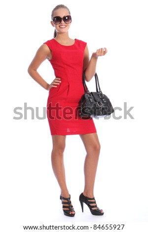 young woman wearing gold high heel shoes standing on the