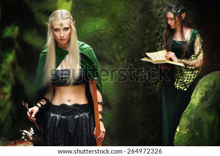 Beautiful sexy young woman elf with bow - stock photo