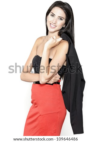 Beautiful sexy young woman in red pencil skirt with her jacket over one shoulder - stock photo