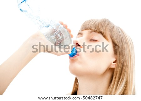 beautiful sexy young woman isolated on white background drinking water form plastic bottle