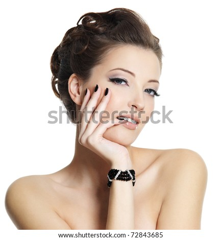 Beautiful sexy young woman with black manicure and stylish hairstyle posing on white background - stock photo