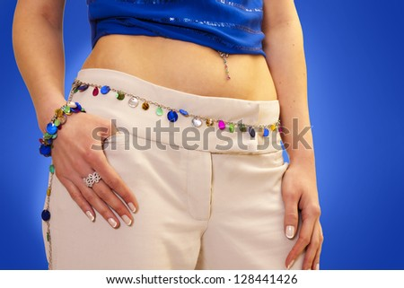 Beautiful shape on this model, she shows it off with colorful belt around her waist and hips. - stock photo