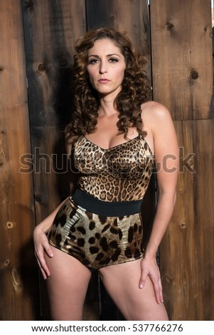 Beautiful shapely brunette in a leopard print bodysuit