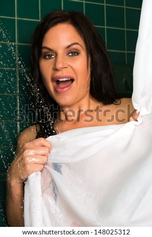 Beautiful shapely brunette in the shower - stock photo