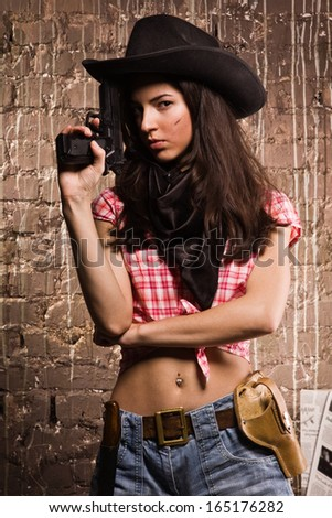 Beautiful sheriff woman on wall background