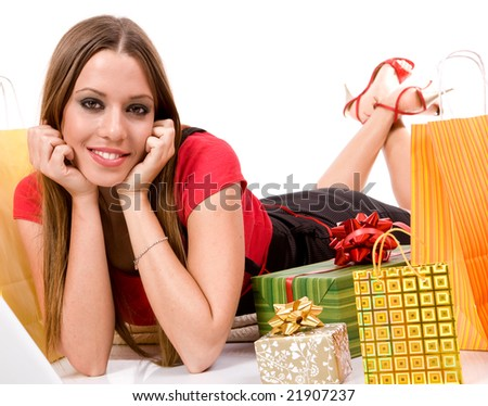 Beautiful shopping girl with bags and boxes. - stock photo
