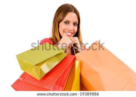 Beautiful shopping girl with colorful bags. - stock photo