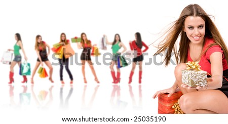Beautiful shopping girl with gift box and friends in background. - stock photo