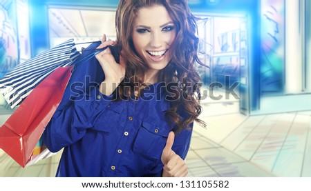Beautiful shopping woman at a drawn mall - stock photo