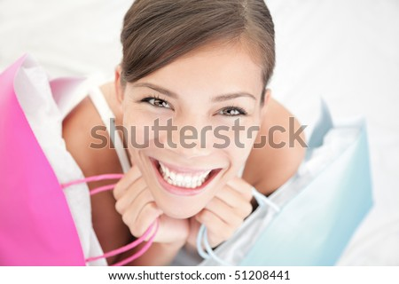 Beautiful shopping woman happy holding shopping bags. - stock photo