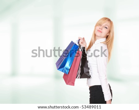 Beautiful shopping woman holding bags in her hands
