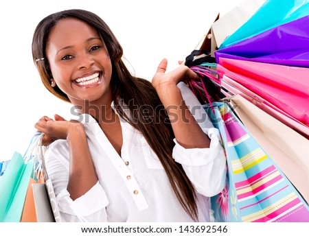 Beautiful shopping woman looking very happy - isolated over white - stock photo