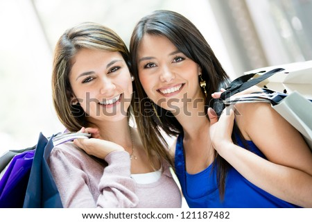 Beautiful shopping women at the mall holding bags - stock photo