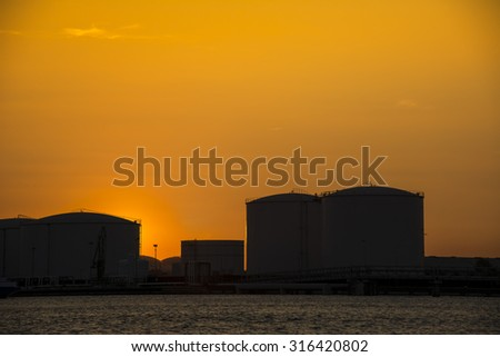 Beautiful silhouette from some oil tanks during a nice sunset.