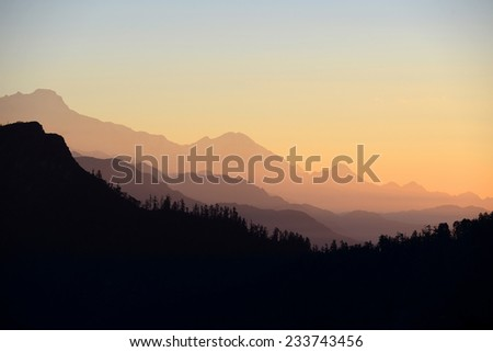 Beautiful silhouette of mountain landscape during sunrise (Poonhill, Nepal) - stock photo